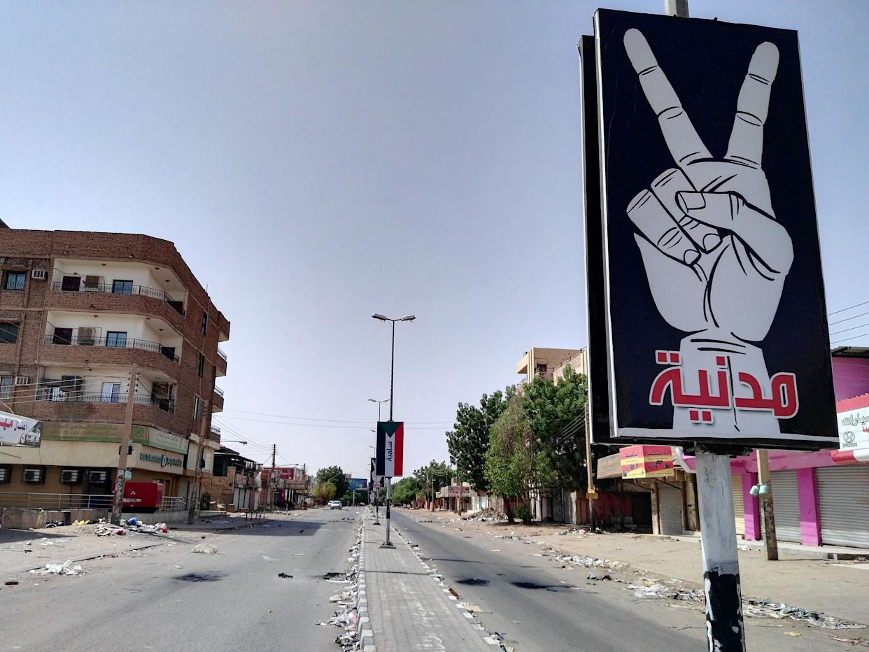 """The U.S. has been slow to involve itself in the crisis, while other nations attempt to broker peace. A placard on Street 60 in anearly deserted Khartoum on June 6 reads: """"Civilian and peaceful."""" (Photo: - /AFP/Getty Images)"""