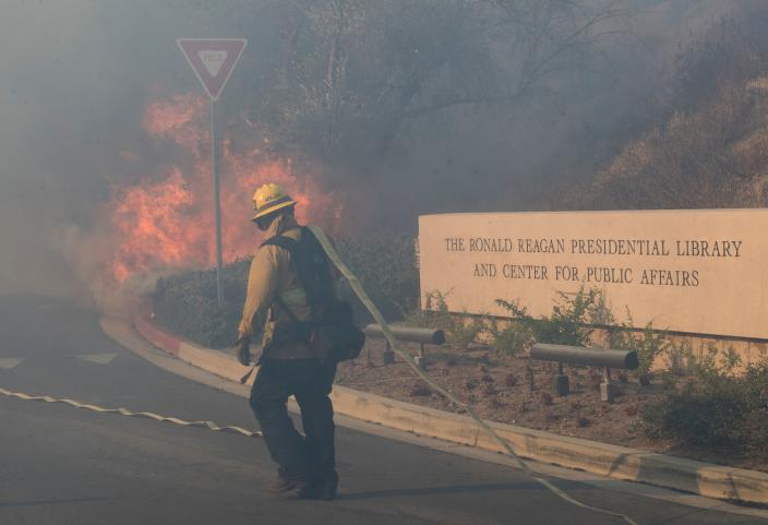 Firefighters battle to protect the Reagan Library from the Easy Fire in Simi Valley, Calif. on Oct. 30, 2019. (Photo: Mark Ralston/AFP via Getty Images)