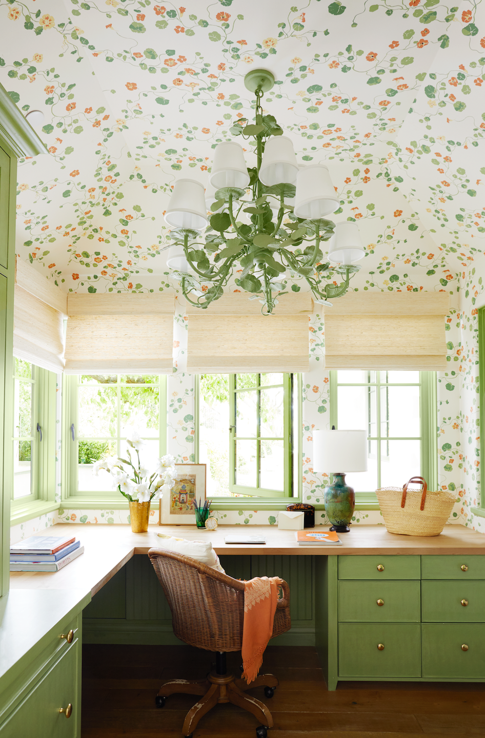 "<p>Of course your home office needs wallpaper on the ceiling. Designer Peter Dunham took this small upstairs room in a guest house in a <a href=""https://www.veranda.com/home-decorators/a30735967/peter-dunham-california-house-tour/"" rel=""nofollow noopener"" target=""_blank"" data-ylk=""slk:Southern California home"" class=""link rapid-noclick-resp"">Southern California home</a> and transformed it to an efficient and exciting space thanks to a built-in workspace with backyard views, nasturtium-themed wallpaper from Lake August and a sage-green Bonhams chandelier that ties the space together. </p>"
