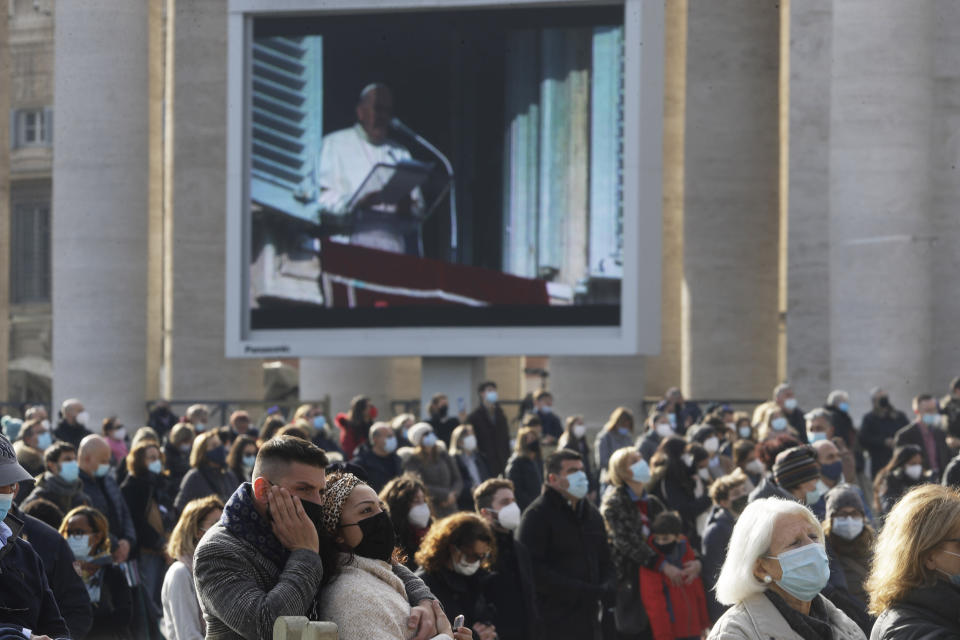 Faithful gather in St. Peter's Square on the occasion of the Angelus prayer at the Vatican, Sunday, Dec. 20, 2020. (AP Photo/Gregorio Borgia)