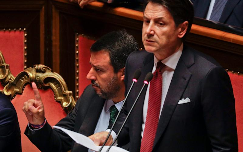 Italian Premier Giuseppe Conte (right) is set to address parliament later today as the possibility of a confidence vote looms.  - AP