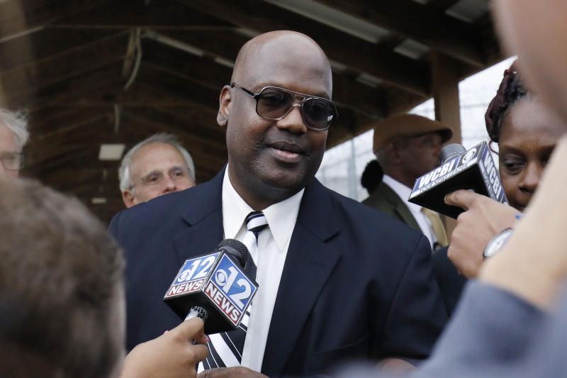 Curtis Flowers speaks with reporters as he exits the Winston-Choctaw Regional Correctional Facility in Louisville, Miss., Monday, Dec. 16, 2019. Flowers' murder conviction was overturned by the U.S. Supreme Court for racial bias was he was granted bond by a circuit judge and is free, with a number of conditions for the first time in 22 years. (AP Photo/Rogelio V. Solis)