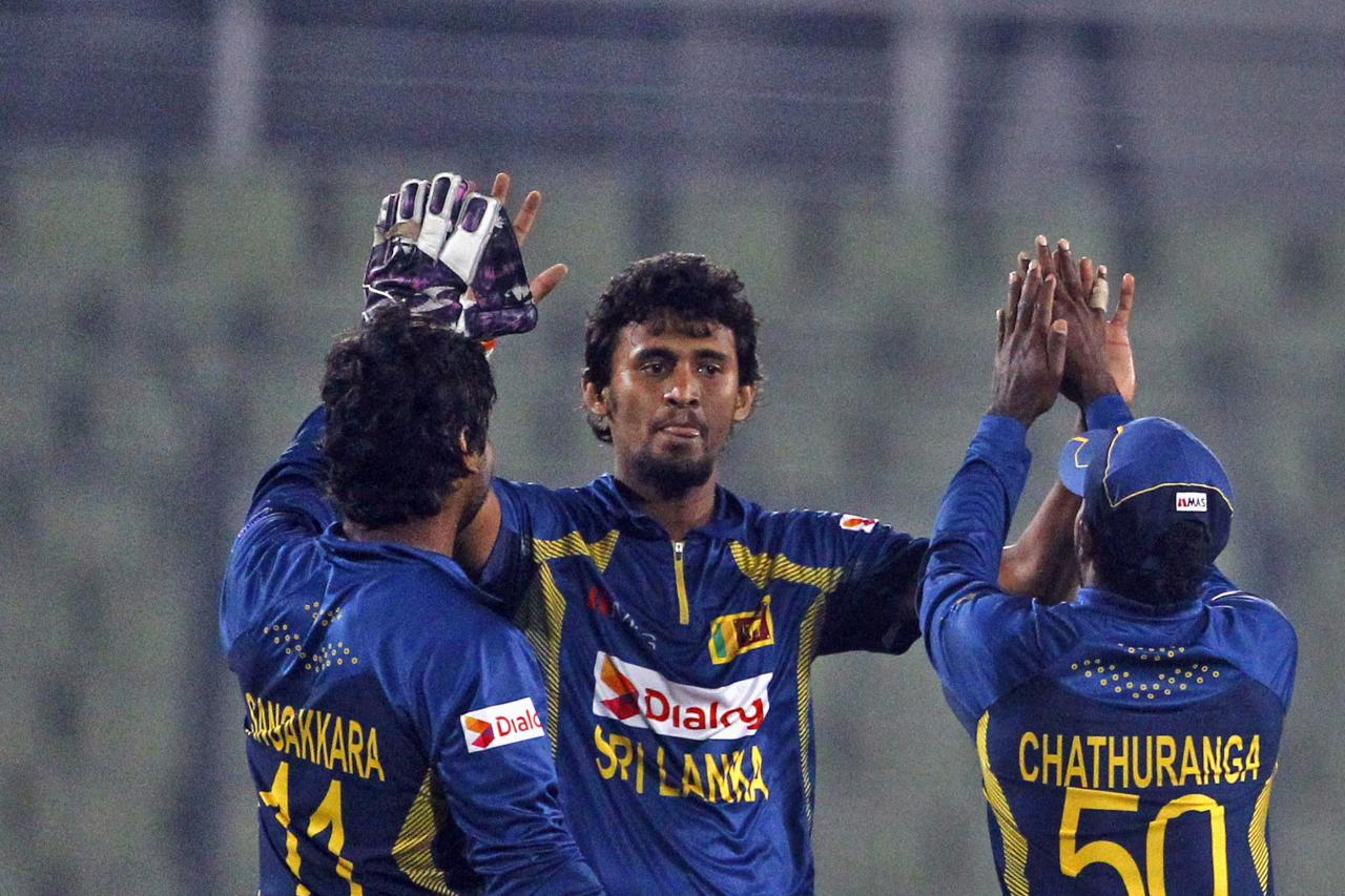 Sri Lanka's Suranga Lakmal, center, celebrates with teammates after taking the wicket of Afghanistan's Samiullah Shenwari during the Asia Cup one-day international cricket tournament between them in Dhaka, Bangladesh, Monday, March 3, 2014. (AP Photo/A.M. Ahad)