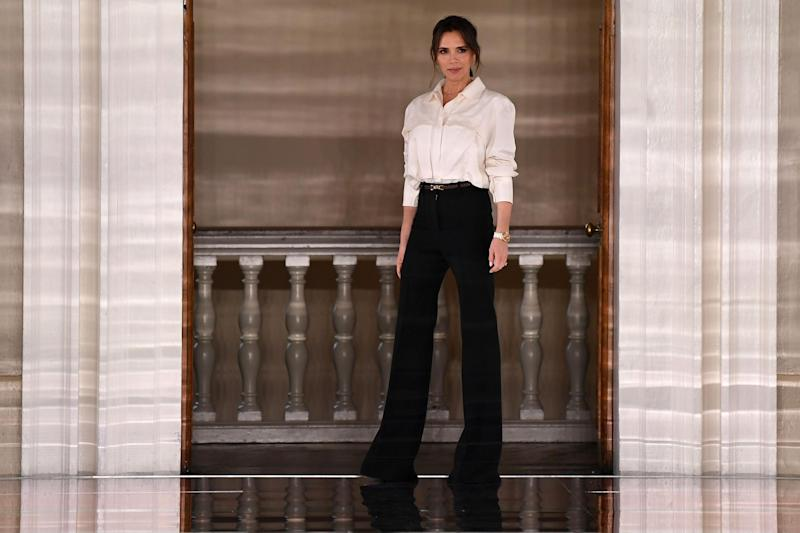 British fashion designer Victoria Beckham reacts after presenting creations for her Autumn/Winter 2020 collection on the third day of London Fashion Week in London on February 16, 2020. (Getty Images)