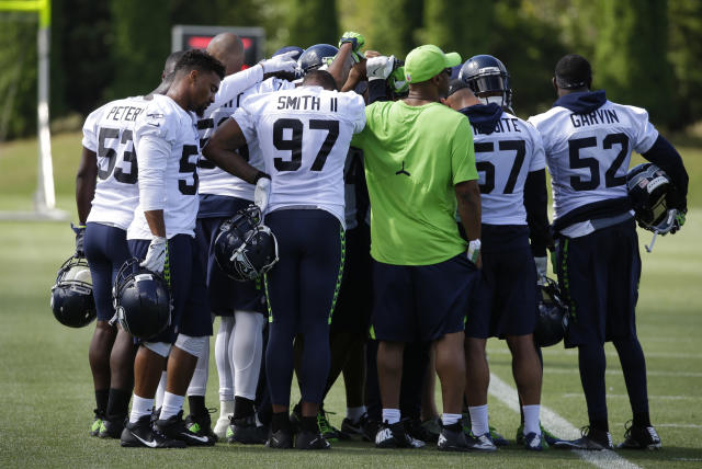 All together now: Seahawks players decided not to be on the field for the playing of the anthem on Sunday. (AP)