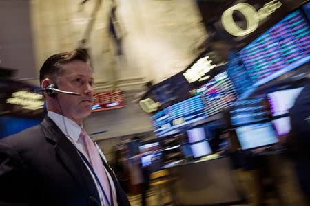 A trader works on the floor of the New York Stock Exchange July 17, 2014. REUTERS/Brendan McDermid