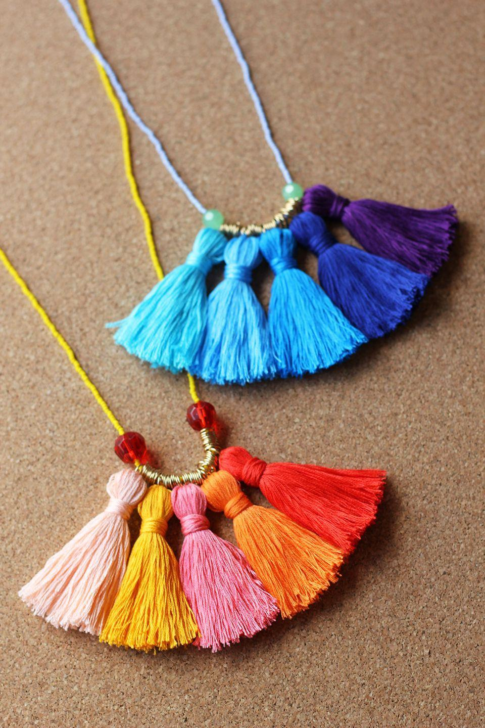 """<p>Make a statement with a colorful accessory that's party-ready. This blogger recommends using a needle to comb through the tassels after wearing to keep them neat and full. </p><p><em><a href=""""http://www.homemadebanana.com/diy-ombre-tassel-necklace/"""" rel=""""nofollow noopener"""" target=""""_blank"""" data-ylk=""""slk:Get the tutorial at Homemade Banana »"""" class=""""link rapid-noclick-resp"""">Get the tutorial at Homemade Banana »</a></em><br></p>"""