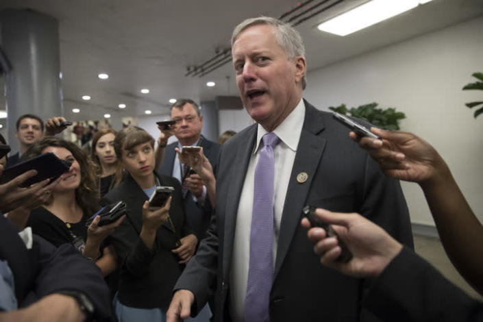 Rep. Mark Meadows, R-N.C., chairman of the conservative House Freedom Caucus, is stopped by reporters as he passes by the Senate. (Photo: J. Scott Applewhite/AP)