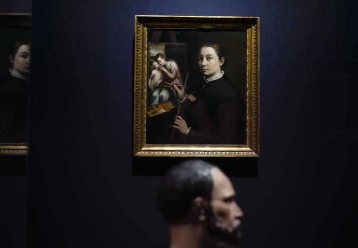 """A self-portrait by Sofonisba Anguissola, titled Self-Portrait at the Easel, painted around 1556-1557, is seen during a press preview of the Remember Me exhibit which brings together international masterpieces of portraiture at the Rijksmuseum in Amsterdam, Netherlands, Tuesday, Sept. 28, 2021. As COVID-19 lockdowns ease and borders reopen, there is a gathering at Amsterdam's Rijksmuseum of people from around Europe, depicted in more than 100 Renaissance portraits. The Dutch national museum's new exhibition """"Remember Me,"""" covers the century 1470-1570. (AP Photo/Peter Dejong)"""