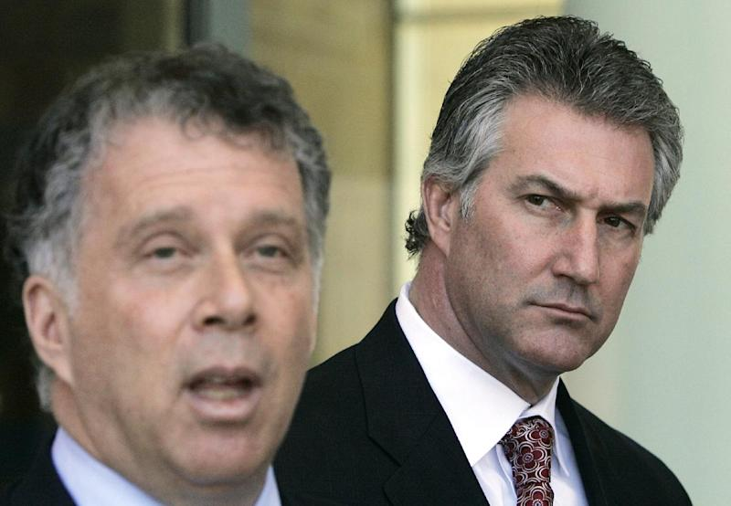 FILE - This March 5, 2008 file photo shows Rep. Rick Renzi, R-Ariz., right,  listening to his lead attorney Reid Weingarten after his arraignment, during a news conference at U.S. District Court in Tucson, Ariz. A federal jury on Tuesday June 11, 2013 convicted Renzi on more than a half dozen corruption charges accusing him of using his office for personal financial gain and looting a family insurance business to help pay for his 2002 campaign. (AP Photo/Ross D. Franklin, File)