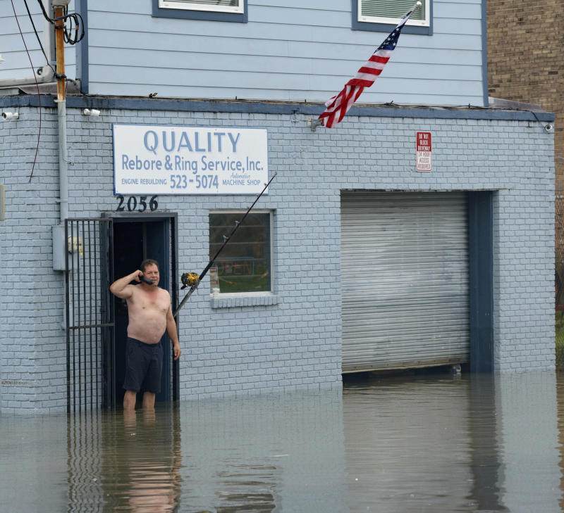 David Fox makes a call from his business on Poydras Street in New Orleans after flooding in New Orleans, July 10, 2019. (Photo: Matthew Hinton/AP)