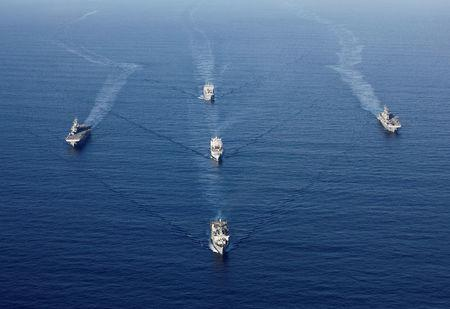 U.S. Navy vessels including the USS Wasp (L), USS Kearsarge (R), USS Oak Hill (front), SS Wright (C) and USNS William McLean (back) maneuver in formation as they skirt around Hurricane Maria before eventually returning to assist the U.S. Virgin Islands, in the Caribbean Sea September 19, 2017. REUTERS/Jonathan Drake