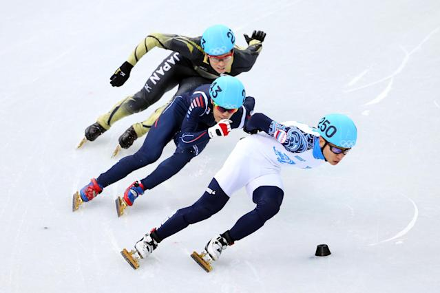 SOCHI, RUSSIA - FEBRUARY 13: (front to back) Victor An of Russia, Da Woon Sin of South Korea and Yuzo Takamido of Japan compete in the Short Track Men's 1000 m Heat on day 6 of the Sochi 2014 Winter Olympics at at Iceberg Skating Palace on February 13, 2014 in Sochi, Russia. (Photo by Quinn Rooney/Getty Images)