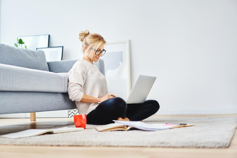 Working from the sofa might seem like a novelty, but it could be causing you some serious back issues. (Getty Images)
