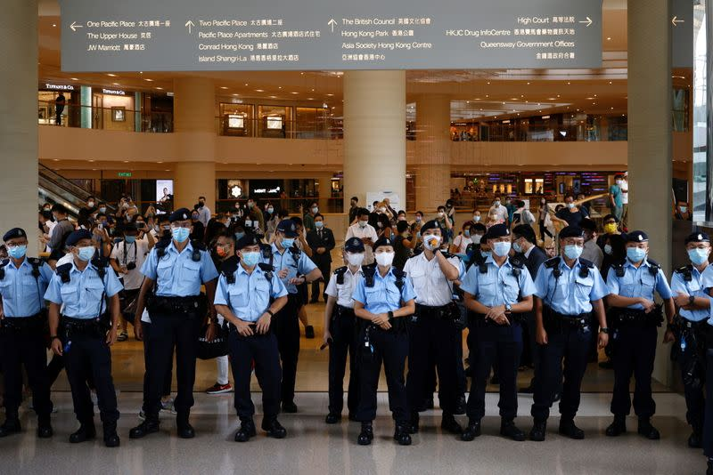 Police ask supporters to leave during the court hearing of Tong Ying-kit, the first person charged under a new national security law near the High Court, in Hong Kong