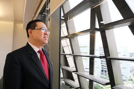 Malaysia's Finance Minister Lim Guan Eng poses for a photograph following an interview with Reuters in Putrajaya