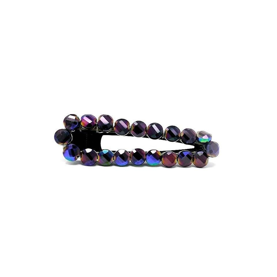"""<p>The iridescent metallic glass stones on the Ibiza Collection Metallic Stone Large Clip by Bellefixe glisten in the light and give off just the right amount of bling. It's large enough to hold a hefty top knot in place or it can make a single bold statement when worn parallel to a deep side part. </p> <p><strong>$16</strong> (<a href=""""https://cna.st/affiliate-link/QfnyHLnF7r67p2NxmCQrssf2mVKzGuTfuJkHdM8aXDEvYGkSGsH9tLaiRRsGKNpygLWWFXNLfesySx1NrKMLQpTQYospQb5q9r7px8ZPa8Jo1gFNPFBNS8kwNgAQiqaSNtwzdCZrpX6AifxPbMqdzZQFS7MesUWrox8Fs216eSrG11cs?cid=601d6581637b3213d10de75a"""" rel=""""nofollow noopener"""" target=""""_blank"""" data-ylk=""""slk:Shop Now"""" class=""""link rapid-noclick-resp"""">Shop Now</a>)</p>"""