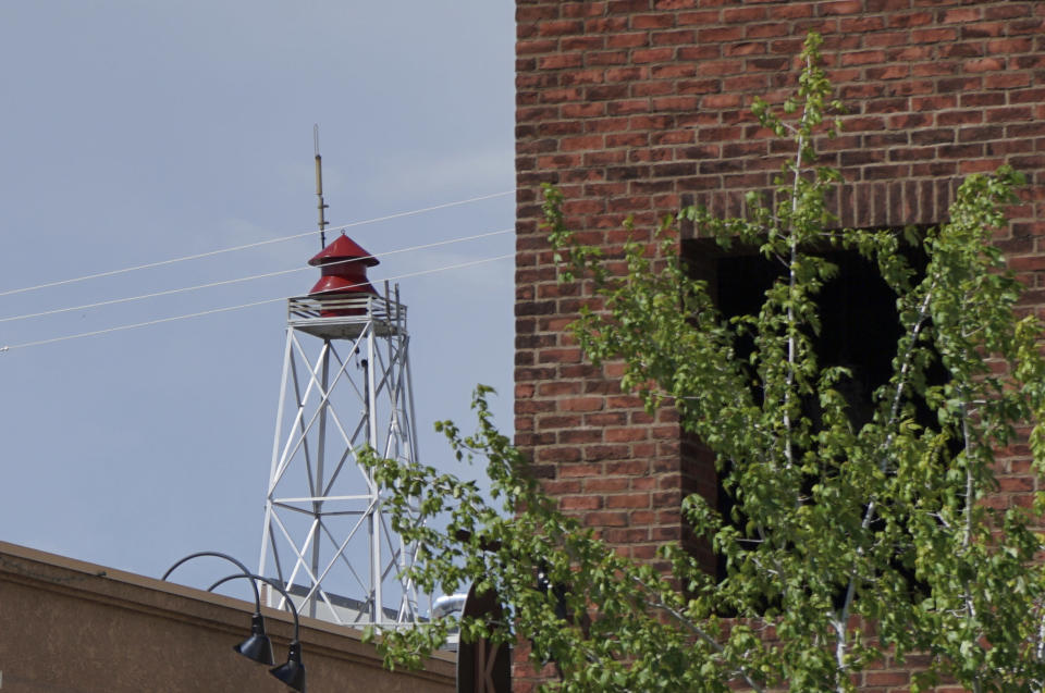 """This June 30 2021 photo shows a century-old siren in Minden, Nev. Efforts to silence the century-old siren that blares every night at 6 p.m. are sparking debates over how to confront the region's history of racism and violence. The Washoe Tribe of Nevada and California associates the siren with a historic """"sundown ordinance"""" that once made it illegal for them to be in Minden and neighboring Gardnerville after nightfall. Residents of the mostly white town defend it as a tradition that marks time and honors first responders. (AP Photo/Sam Metz)"""