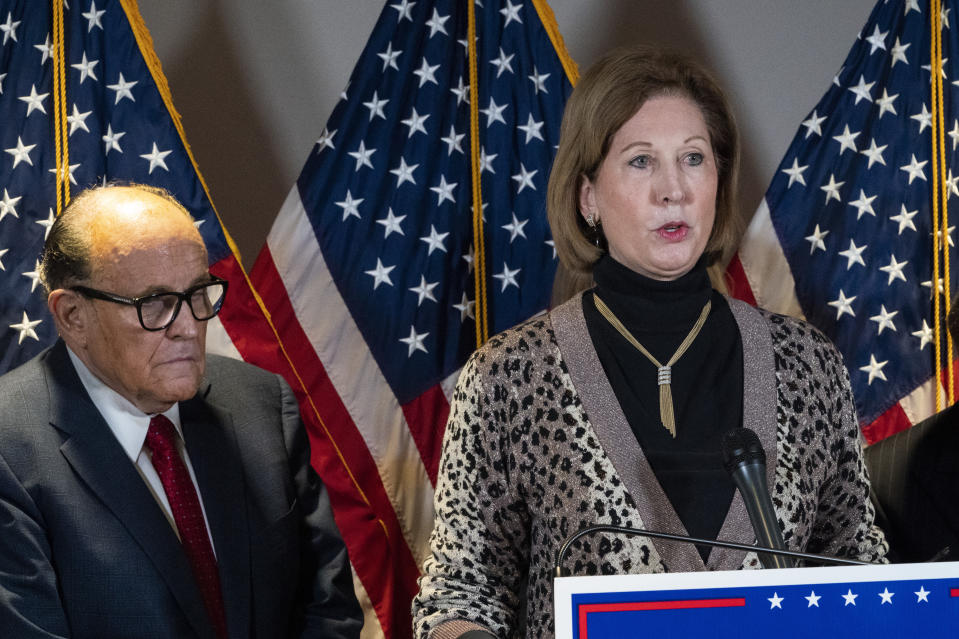FILE - In this Nov. 19, 2020 file photo, Sidney Powell, right, speaks next to former Mayor of New York Rudy Giuliani, as members of President Donald Trump's legal team, during a news conference at the Republican National Committee headquarters in Washington. On Friday, June 4, 2021, The Associated Press reported on stories circulating online incorrectly asserting election technology firm Dominion Voting Systems lost its lawsuits against Powell and Giuliani. Dominion's defamation lawsuits against the pair are ongoing, according to legal records. (AP Photo/Jacquelyn Martin, File)