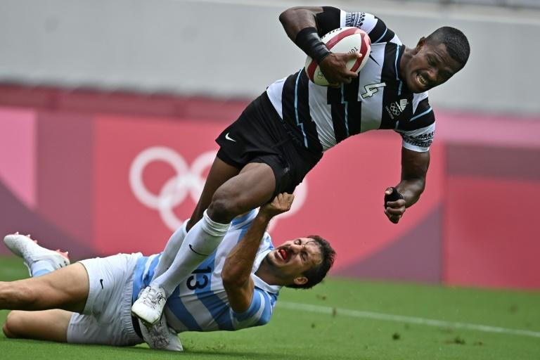Jiuta Wainiqolo (R) scored five tries during this summer's Olympic Games victory (AFP/Ben STANSALL)