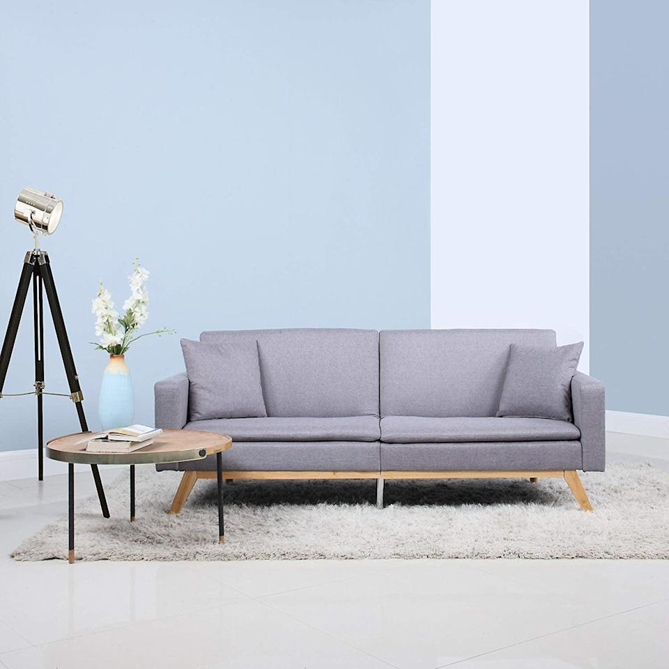 <p>We're into the wood details on this <span>Divano Roma Furniture Linen Sleeper Futon Sofa</span> ($359).</p>