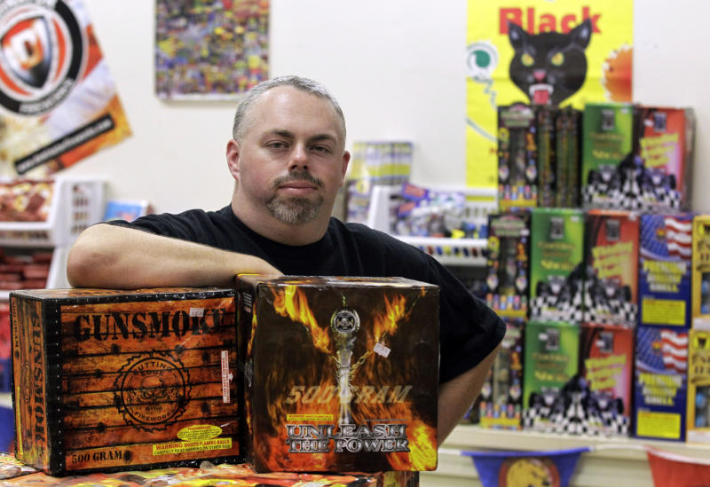 In this Thursday, June 28, 2012 photo, Paul Forman, owner of Independence Fireworks and Forman Blasters Pyrotechnics in Peru, Ind., poses in his store. Forman says he understands the safety concerns but says his countyís decision to declare a disaster emergency has devastated his business. Four customers had already called off fireworks shows this week, and he anticipated more cancellations before the holiday. He said his business had dropped from around 50 customers a day to a total of 11 since the ban went into effect June 25. (AP Photo/Michael Conroy)