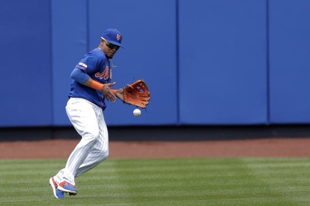 New York Mets center fielder Juan Lagares misplays a ball hit by Washington Nationals' Trea Turner during the fifth inning of a baseball game, Thursday, May 23, 2019, in New York. (AP Photo/Julio Cortez)