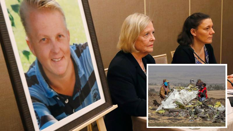 The mother of American victim Jonathan Seex of the Ethiopia plane crash, Britt-Marie Seex sits next to a photo of her son with widow Nadege Dubois-Seex on her right. (AP Photo/Michel Euler)