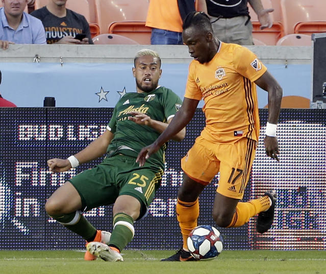 Portland Timbers defender Bill Tuiloma (25) tries to take the ball from Houston Dynamo forward Alberth Elis (17) during the first half of an MLS soccer match Wednesday, May 15, 2019, in Houston. (AP Photo/Michael Wyke)