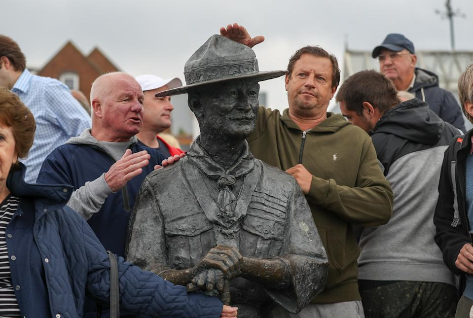"""Local residents show their support for a statue of Robert Baden-Powell on Poole Quay in Dorset ahead of its expected removal to """"safe storage"""" following concerns about his actions while in the military and """"Nazi sympathies"""". The action follows a raft of Black Lives Matter protests across the UK, sparked by the death of George Floyd, who was killed on May 25 while in police custody in the US city of Minneapolis."""