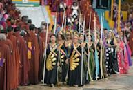 Female Vale do Amanecer wear colorful dresses and veils that shine under the sun, while men don Roman-style capes