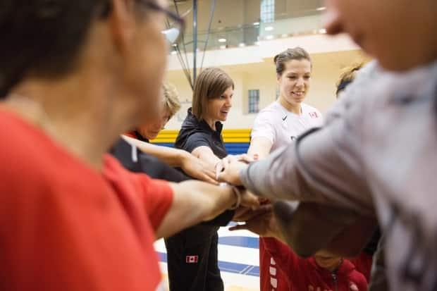 Team Canada head coach Lisa Thomaidis leads the team during a 2016 training camp. Canada Basketball was forced to move its upcoming camp to Tampa, Fla., due to ongoing pandemic restrictions in Canada. (Michelle Siu/The Canadian Press - image credit)