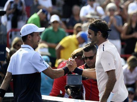 Aug 11, 2017; Montreal, Quebec, Canada; Roberto Bautista Agut of Spain (left) shakes hands with Roger Federer of Switzerland after their match during the Rogers Cup tennis tournament at Uniprix Stadium. Mandatory Credit: Eric Bolte-USA TODAY Sports