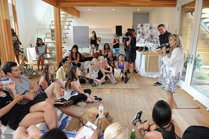 """<p>Laura, holding the mic on the right, addresses guests at the Well-thy Home wellness retreat she hosted this summer. """"It really almost killed us getting to the deadline"""" so the house would be ready in time for the event, she says.<br></p>"""