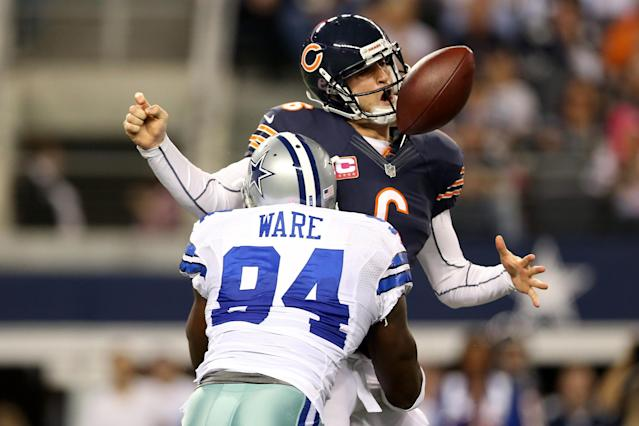 ARLINGTON, TX - OCTOBER 01: Jay Cutler #6 of the Chicago Bears fumbles the ball as he is sacked by DeMarcus Ware #94 of the Dallas Cowboys in the third quarter at Cowboys Stadium on October 1, 2012 in Arlington, Texas. (Photo by Ronald Martinez/Getty Images)