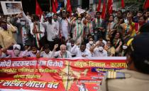 Members of the Communist Party of India (CPI) protest against farm laws during a nationwide strike, in Mumbai