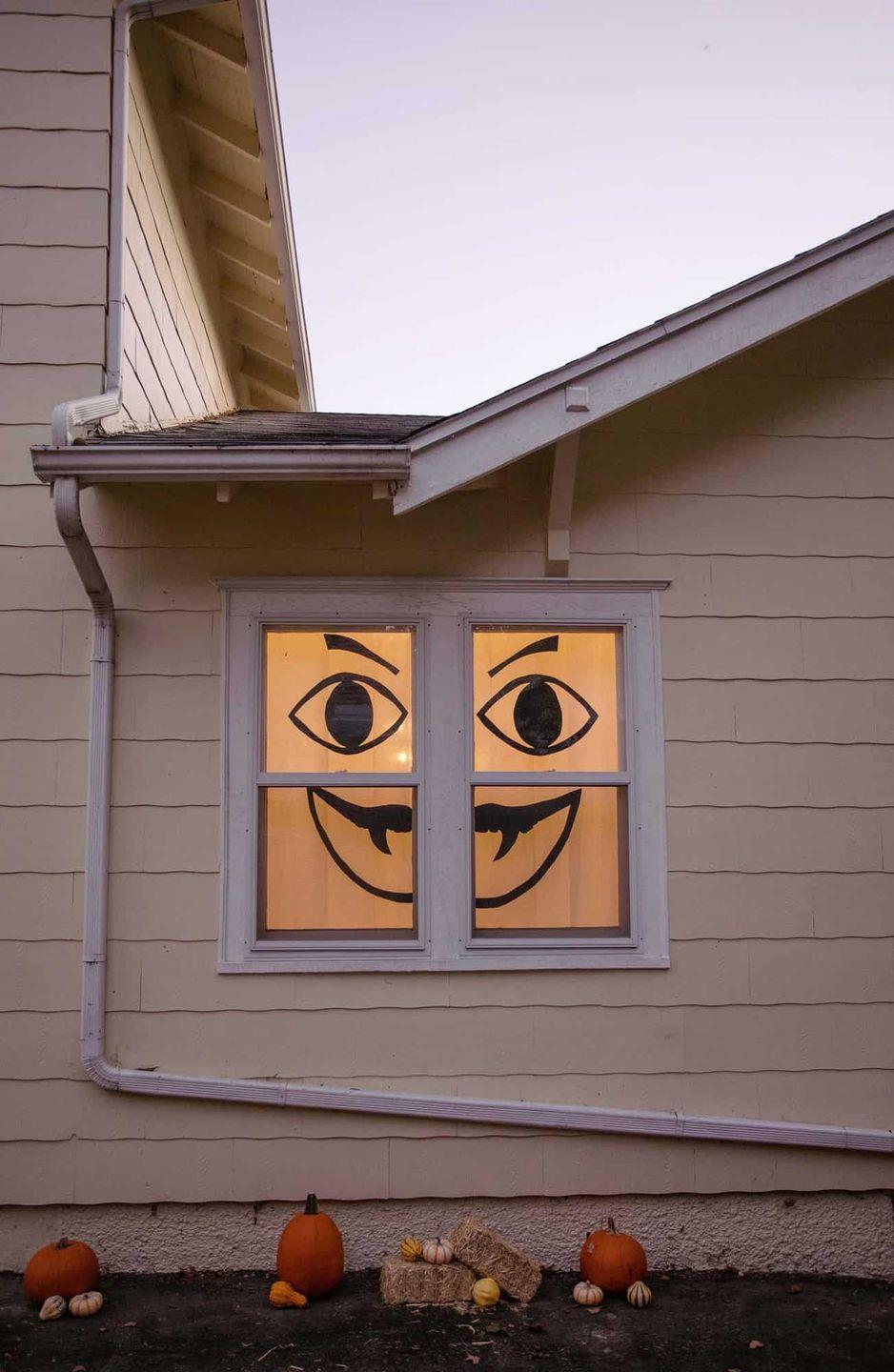 """<p>Give passersby a fall fright by pasting spooky faces inside any front-facing windows on your porch. </p><p><a class=""""link rapid-noclick-resp"""" href=""""https://abeautifulmess.com/easy-halloween-window-decor/"""" rel=""""nofollow noopener"""" target=""""_blank"""" data-ylk=""""slk:GET THE TUTORIAL"""">GET THE TUTORIAL</a></p>"""