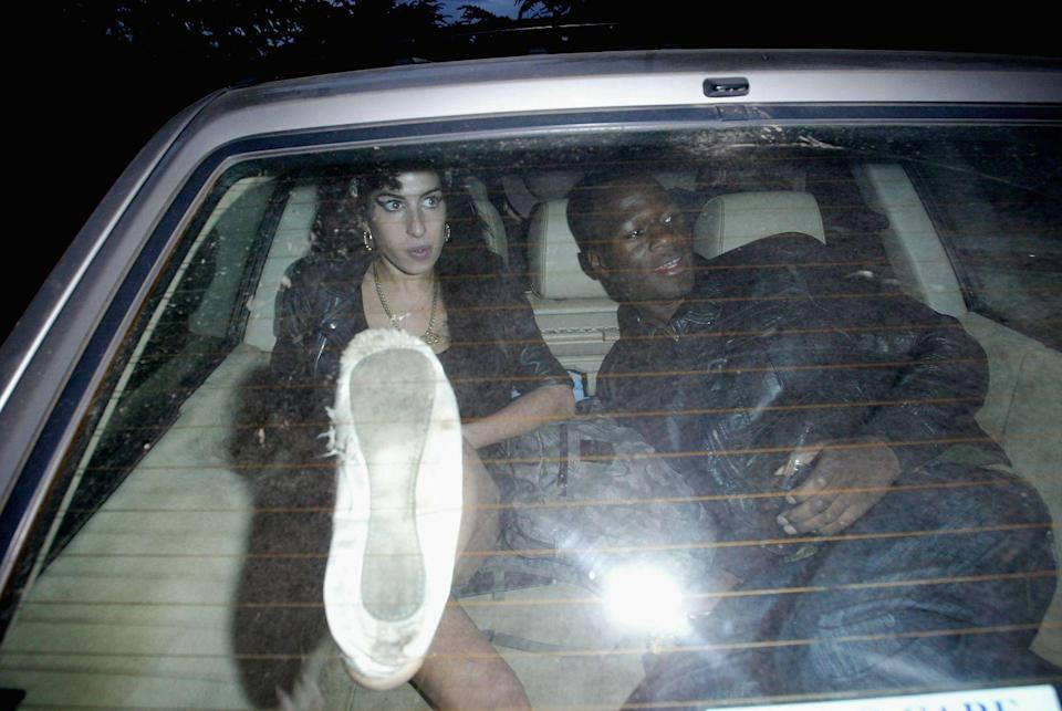 <p>Amy Winehouse drives away from the back entrance of the Bacardi B-Live VIP Area in the boot of her car with her backing singer Ade after celebrating her set on Day Three of the T In The Park music festival on July 13, 2008 in Kinross, Scotland. </p>