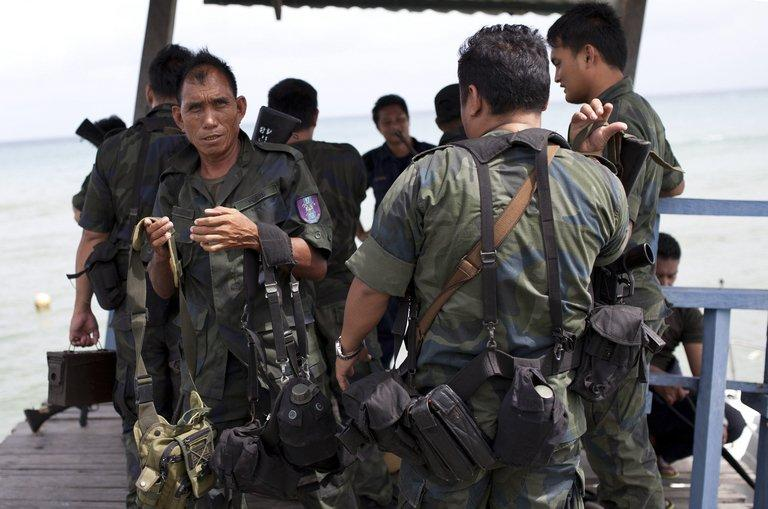 Malaysian policemen return from a sea patrol in Tanjung Labian near Lahad Datu, on February 16, 2013