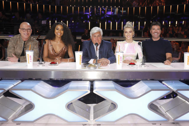 Jay Leno guest judges AGT with Howie Mandel, Gabrielle Union, Jay Leno, Julianne Hough and Simon Cowell (Credit: NBCUniversal via Getty Images)