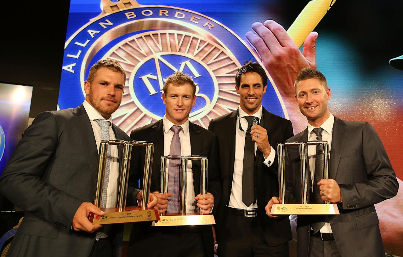 SYDNEY, AUSTRALIA - JANUARY 20:  (L-R) Aaron Finch, George Bailey, Mitchell Johnson and Michael Clarke pose with their awards during the 2014 Allan Border Medal at Doltone House on January 20, 2014 in Sydney, Australia.  (Photo by Mark Metcalfe/Getty Images)