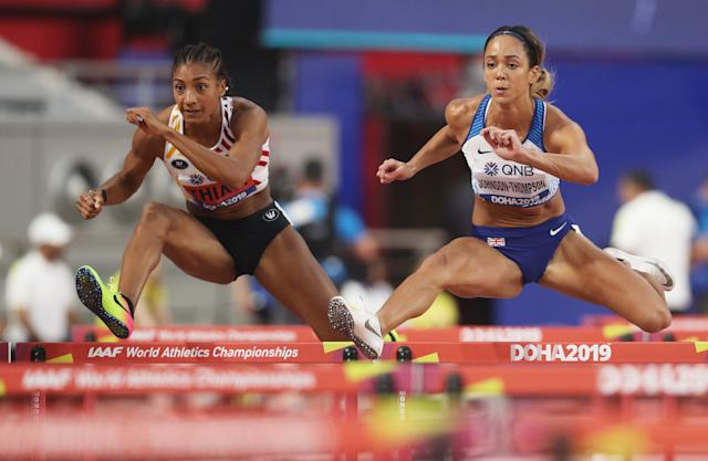 DOHA, QATAR - OCTOBER 02: Nafissatou Thiam of Belgium and Katarina Johnson-Thompson of Great Britain compete in the Women's Heptathlon 100 metres hurdles during day six of 17th IAAF World Athletics Championships Doha 2019 at Khalifa International Stadium on October 02, 2019 in Doha, Qatar. (Photo by Patrick Smith/Getty Images)