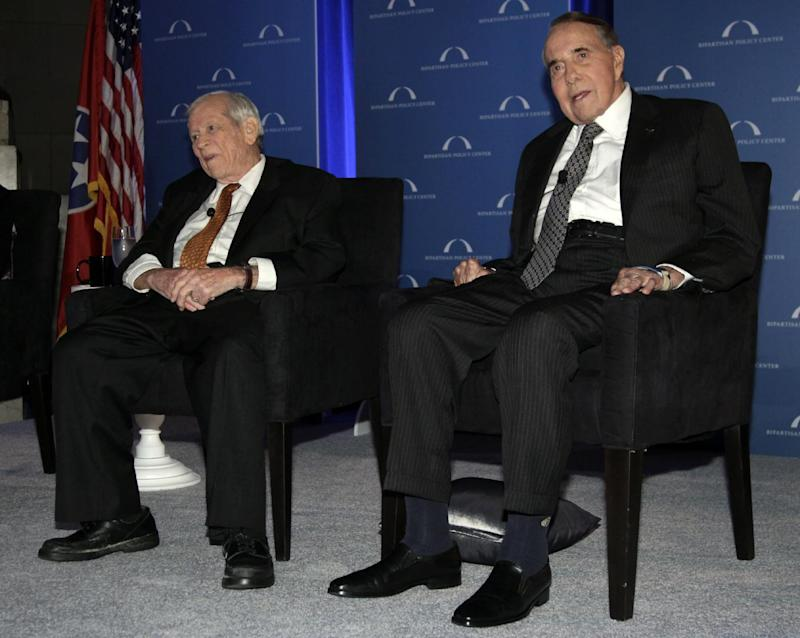 """Former U.S. Senate Majority Leaders  Bob Dole, right, and Howard Baker sit next tot the stage as Vice President Joe Biden, not seen, speaks at """"A Century of Service"""" honoring them at Mellon Auditorium, Wednesday, March 21, 2012, in Washington. (AP Photo/Carolyn Kaster)"""