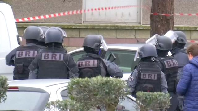French police raid airport attacker house