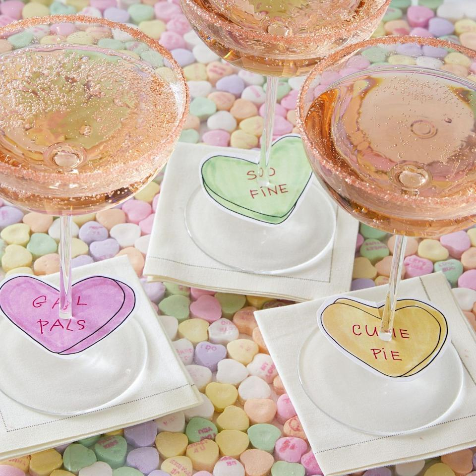 "<p>Make your Galentine's Day celebration even more festive by adding heart-shaped charms to glasses of bubbly. It's a fun way to celebrate your best girlfriends.<br></p><p>Via <em><a href=""http://www.darcymillerdesigns.com/ideas/galentines-day-champagne-charms/"" target=""_blank"">Darcy Miller</a> </em></p><p><a class=""body-btn-link"" href=""https://go.redirectingat.com?id=74968X1596630&url=https%3A%2F%2Fwww.williams-sonoma.com%2Fproducts%2Fvalentines-day-stemware-toasting-flutes%2F%3FcatalogId%3D21%26sku%3D5775646%26cm_ven%3DPLA%26cm_cat%3DGoogle%26cm_pla%3DTabletop%2B%2526%2BBar%2B%253E%2BWine%2BGlasses%2B%253E%2BChampagne%26cm_ite%3D5775646%26gclid%3DCj0KCQiAsvTxBRDkARIsAH4W_j-yKwwETF0CtalgSlN1hm1jz4D9sGtECEb9ETtfJPeY4xUJVzNzmlcaAqxqEALw_wcB&sref=http%3A%2F%2Fwww.elledecor.com%2Flife-culture%2Ffun-at-home%2Fg2387%2Fvalentines-day-decor%2F"" target=""_blank"">GET THE LOOK</a><br><em>Valentine's Day Stemware, Williams Sonoma, $24</em><br></p>"