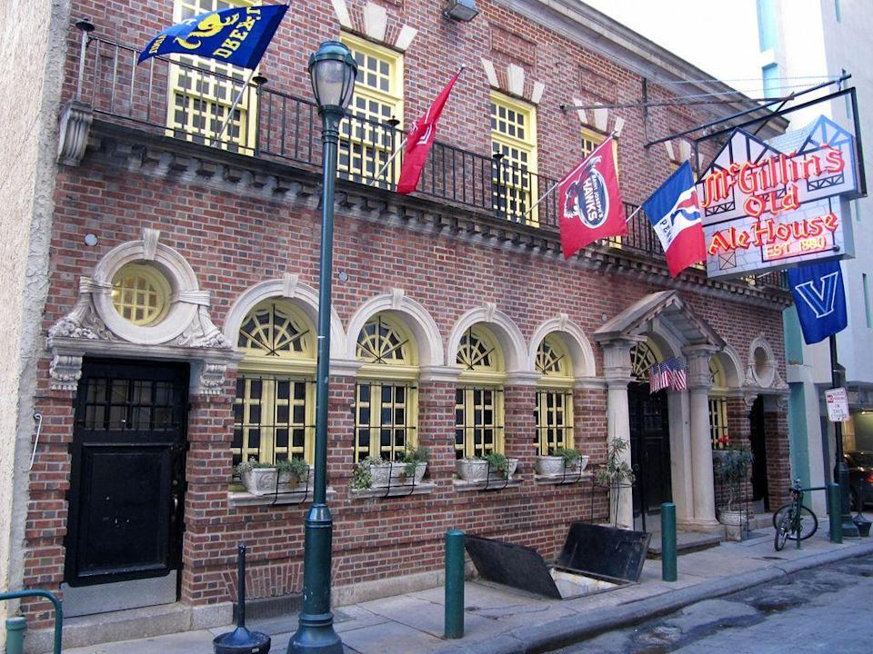 """<p>Opened just before the start of the Civil War, this <a href=""""https://www.tripadvisor.com/Restaurant_Review-g60795-d524387-Reviews-McGillin_s_Olde_Ale_House-Philadelphia_Pennsylvania.html"""" rel=""""nofollow noopener"""" target=""""_blank"""" data-ylk=""""slk:longstanding restaurant and tavern"""" class=""""link rapid-noclick-resp"""">longstanding restaurant and tavern</a> (established in 1860) has really seen it all. Tea replaced alcohol here during Prohibition, but now the joint serves up cheesesteaks and hosts karaoke in a vibrant pub atmosphere.</p>"""
