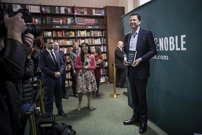 """""""A Higher Loyalty"""" by former FBI chief James Comey, seen here giving a talk in a New York bookstore, has also tapped into Americans' fascination with the Trump presidency (AFP Photo/Drew Angerer)"""
