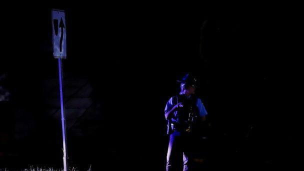 PHOTO: A policeman watches over the traffic in the dark after the fire registered in the Monacillos power substation, in San Juan, Puerto Rico, June 10, 2021. (Thais Llorca/EPA-EFE/Shutterstoc)