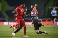 Lyon's Marcal, right, duels for the ball with Bayern's Serge Gnabry during the Champions League semifinal soccer match between Lyon and Bayern at the Jose Alvalade stadium in Lisbon, Portugal, Wednesday, Aug. 19, 2020. (Franck Fife/Pool via AP)