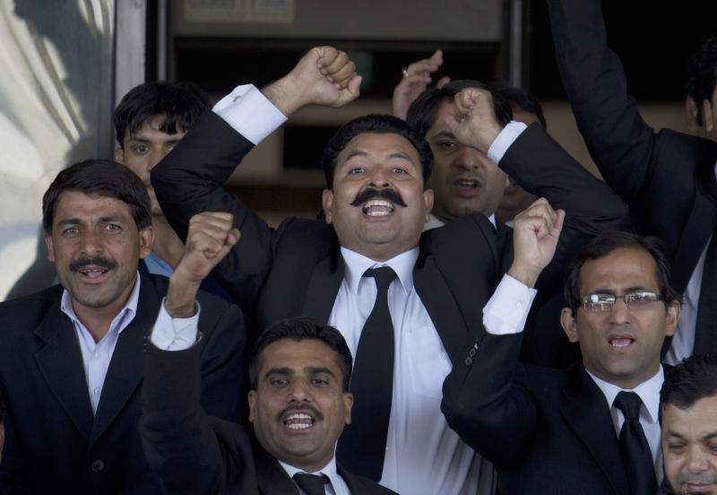 Pakistani lawyers chant slogans in favor of the Supreme Court's decision against Pakistan's Prime Minister, Yousuf Reza Gilani, not pictured, outside the court in Islamabad, Pakistan on Tuesday, June 19, 2012. Pakistan's top court ruled Tuesday that Gilani was no longer eligible to hold office due to an earlier contempt conviction, ushering in fresh political turmoil in the nuclear-armed country. (AP Photo/B.K. Bangash)